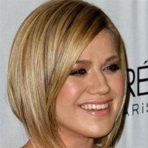 Стрижка на волосы средней длины для круглого лица