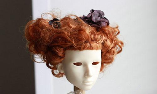 К чему снится примерять волосы